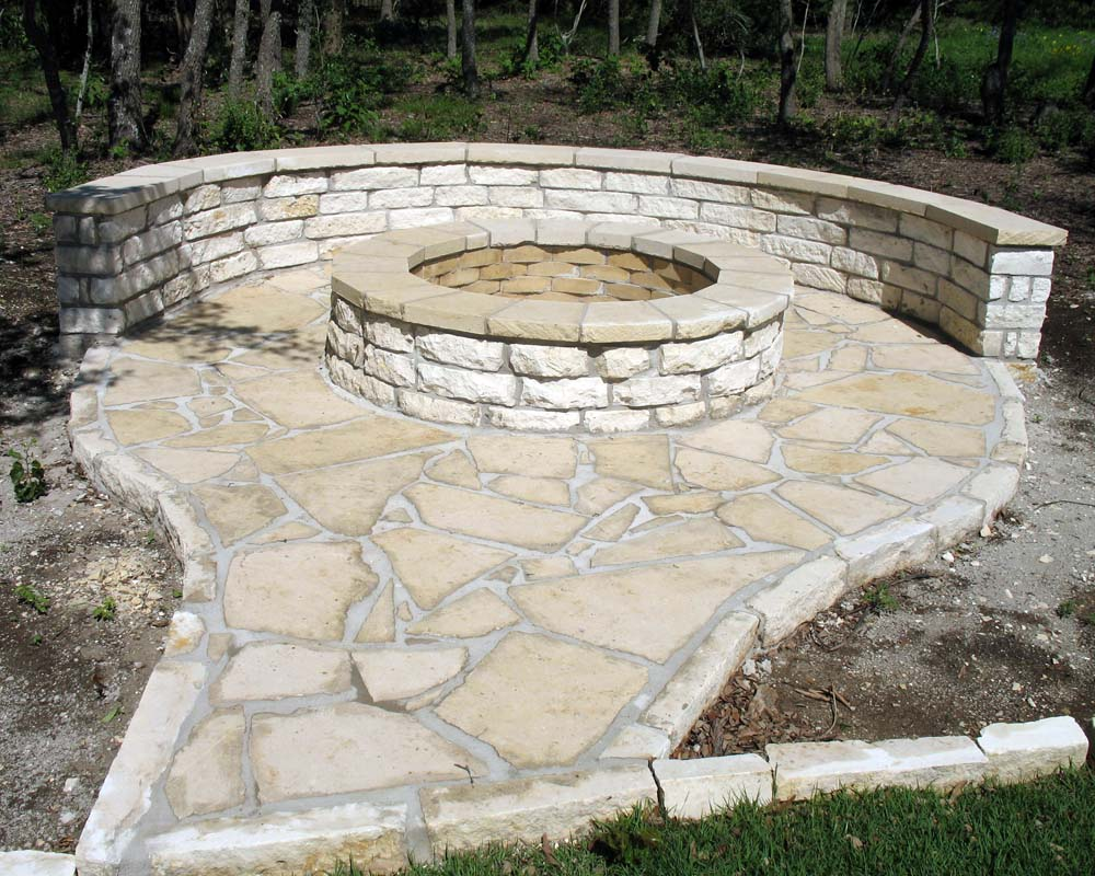 rustic limestone firepit and patio wall
