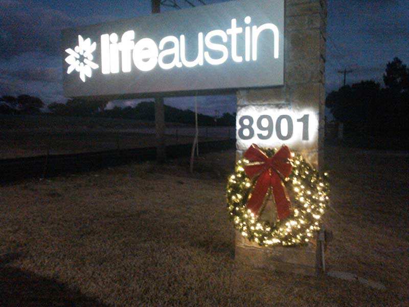 Life Austin sign enhancement with a Christmas wreath.